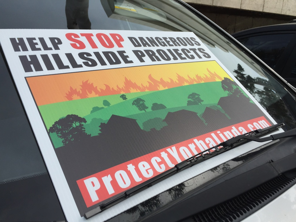Yorba Linda residents are protesting a proposed 340-single family home development slated just north of the city because of fears existing roads wouldn't be able to handle increased traffic during a wildfire evacuation.