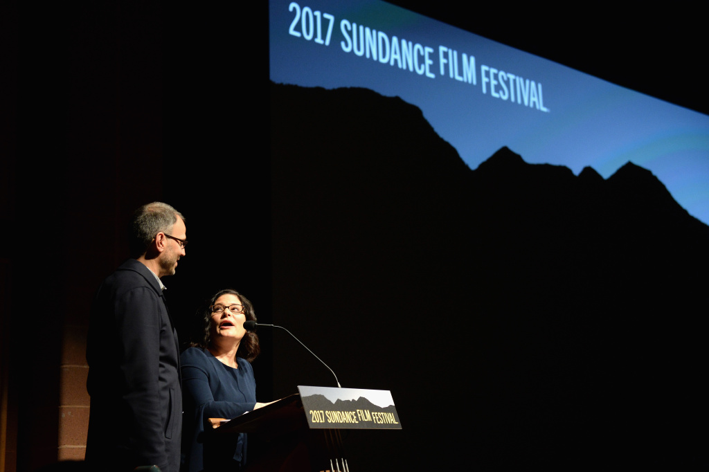 (L-R) Co-director and cinematographer Jon Shenk and co-director Bonni Cohen speak at the premiere of