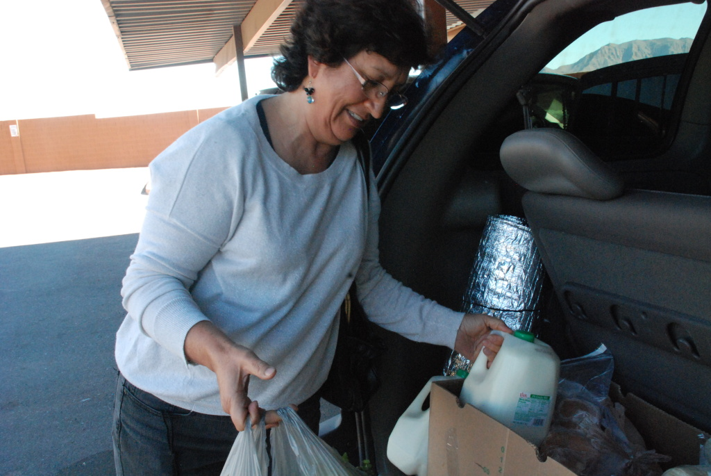 Olga Perez unloads groceries she picked up at East Valley Family Services. She says the healthy food has provided relief for her family.