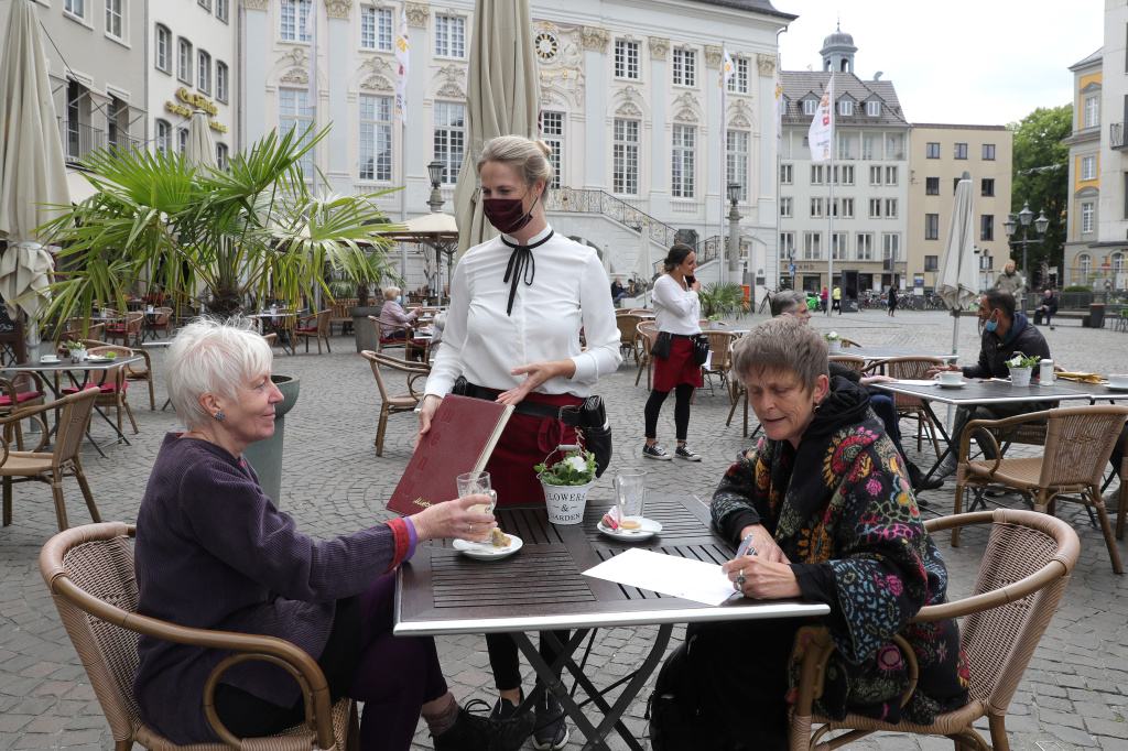 Outdoor dining in Bonn. Indoor dining is riskier than outdoor meals, say the experts. Outdoor air can disrupt viral particles that have been expelled.