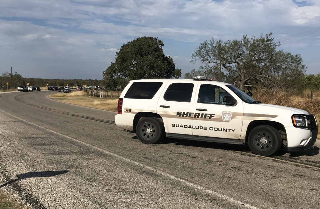Police block a road in Sutherland Springs, Texas on November 5, 2017, after a mass shooting a church nearby.