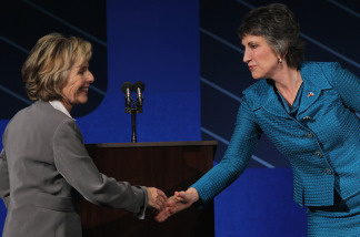 U.S. Sen. Barbara Boxer (D-CA) shakes hands with republican candidate for U.S. Senate Carly Fiorina at the conclusion of a debate on the campus of Saint Mary's College September 1, 2010.