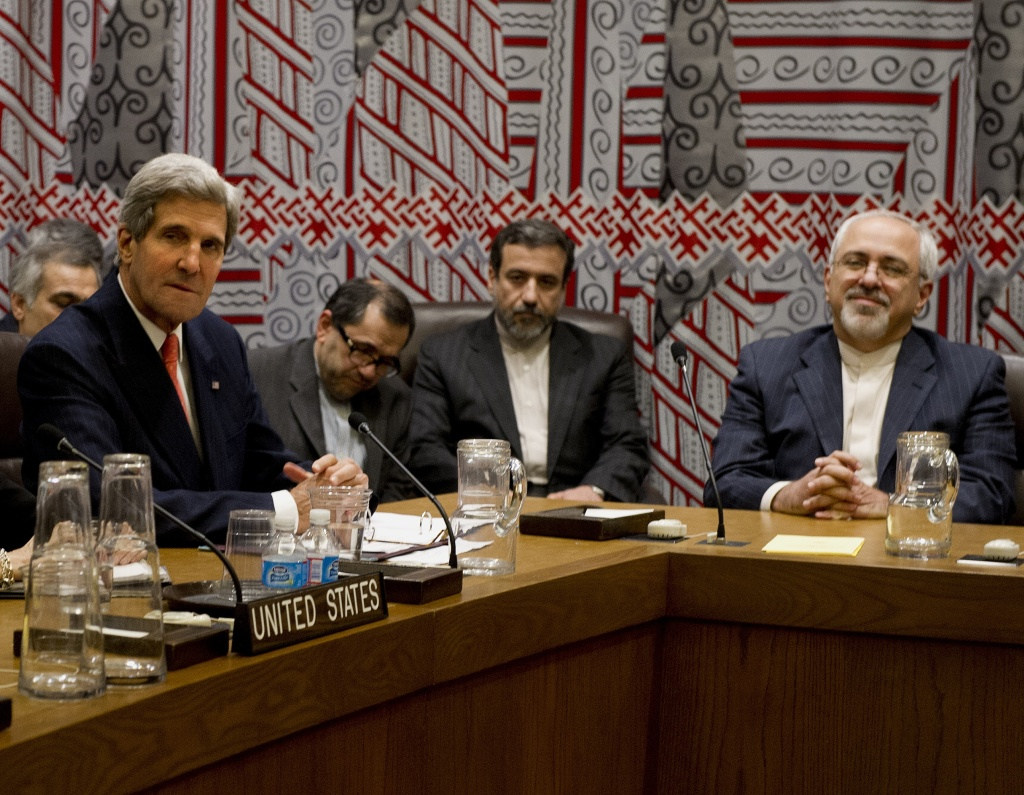 US Secretary of State John Kerry (L) and Iran's Foreign Minister Mohammad-Javad Zarif (R) attend a meeting of the five permanent members of the United Nations Security Council plus Germany about Iran's nuclear program September 26, 2013 on the sidelines of the General Assembly at UN headquarters in New York.
