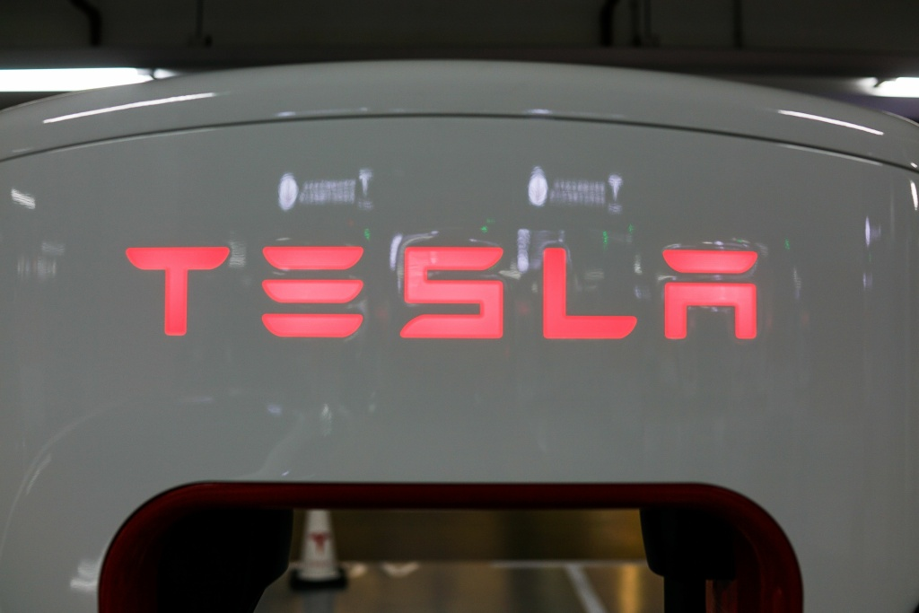 File: A Tesla logo is seen at a charging station inside a mall in Shanghai on Oct. 23, 2017.