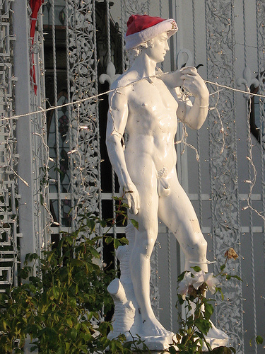 One of the David statues at Youngwood Court celebrates the holiday season.