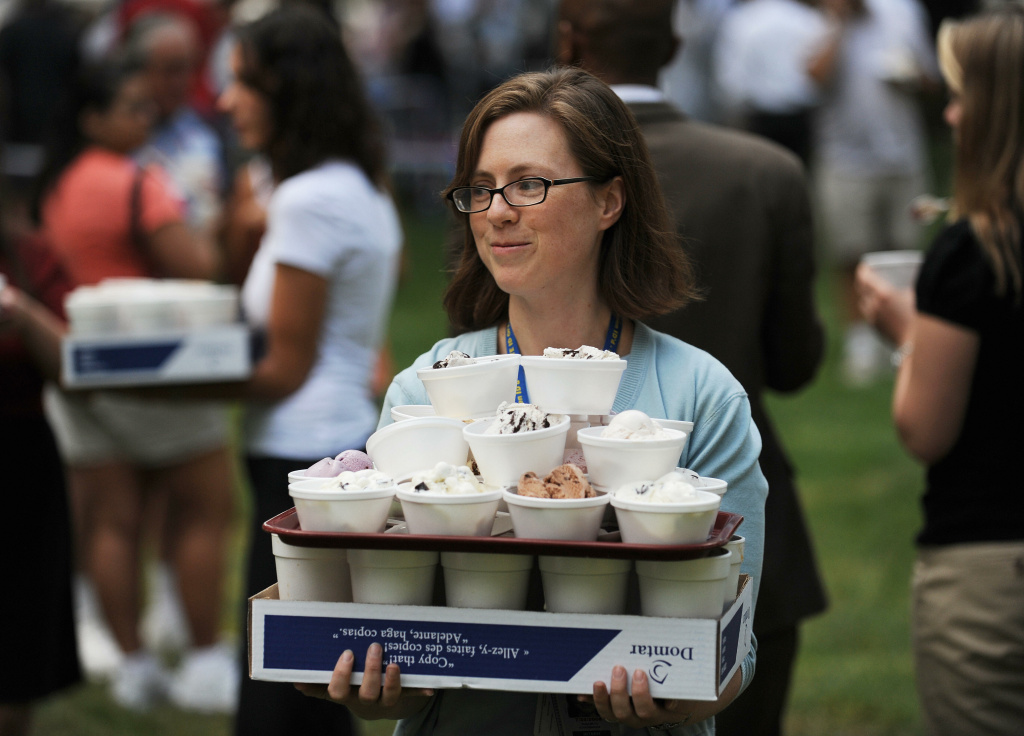 Beth Stockbridge, an intern with the US Senate Office of Legislative Council  brings free sundaes to co-workers who could not leave their offices during The International Ice Cream Association, the Milk Industry Foundation, and the National Cheese Institute 26th annual Capitol Hill Ice Cream Party on June 19, 2008 on Capitol Hill in Washington, DC.