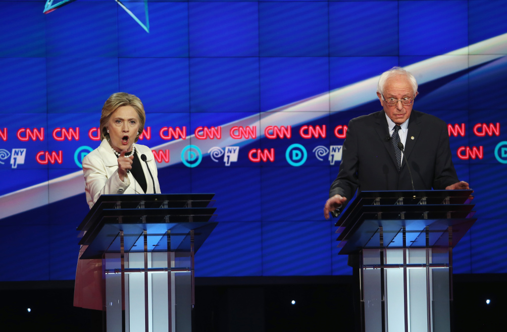 File: Democratic Presidential candidates Hillary Clinton and Sen. Bernie Sanders (D-VT) debate during the CNN Democratic Presidential Primary Debate at the Duggal Greenhouse in the Brooklyn Navy Yard on April 14, 2016 in New York City.