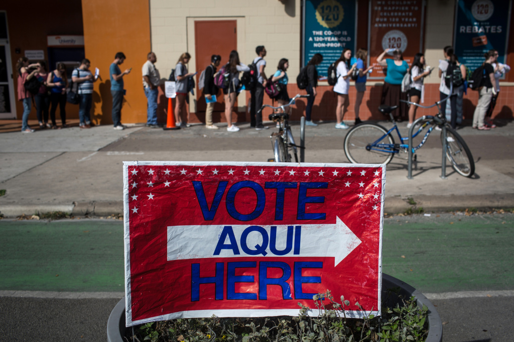 Voters wait in line to cast their Super Tuesday ballots at a polling station at the University Co-op in Austin, Texas, on March 1, 2016. Voters from Vermont to Colorado, Alaska to American Samoa and a host of states in between were heading to polling places and caucus sites on the busiest day of the 2016 primaries.  (AP Photo/Tamir Kalifa)