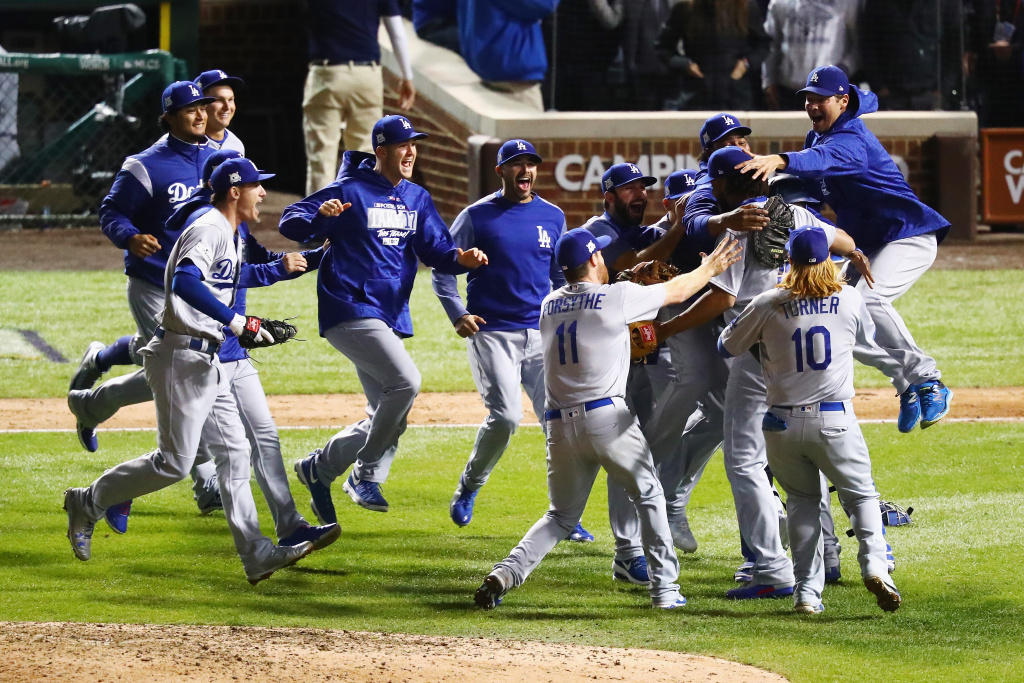 The Los Angeles Dodgers celebrate defeating the Chicago Cubs 11-1 in game five of the National League Championship Series at Wrigley Field on October 19, 2017 in Chicago, Illinois. The Dodgers advance to the World Series.