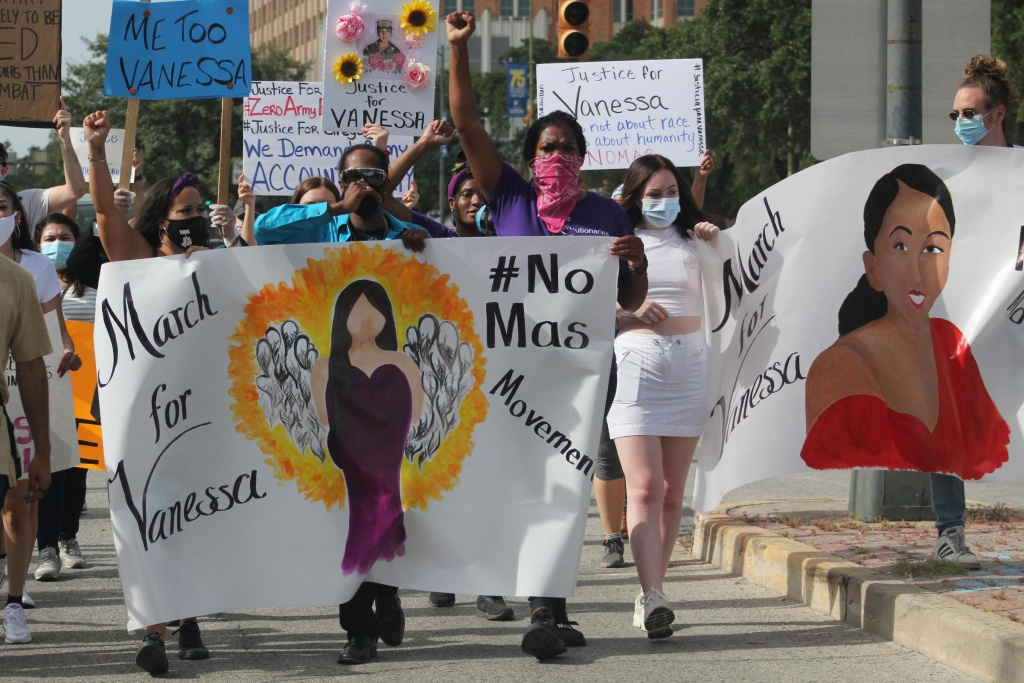Josey Garcia, Pharaoh Clark, and Jourdyn Parks hold a banner as they march through San Antonio in July, shortly after Vanessa Guillen's body was found near Fort Hood.
