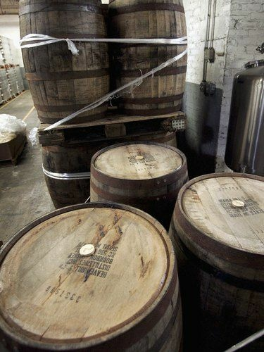 Used bourbon barrels like these at the Goose Island Brewery in Chicago are finding new life by bringing distinctive flavor to beer, cocktails and hot sauce.