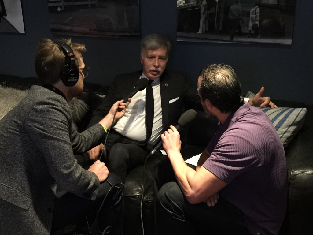 Take Two host A Martinez (right) and producer Jacob Margolis (left) interview Los Angeles Rams owner Stan Kroenke (center).