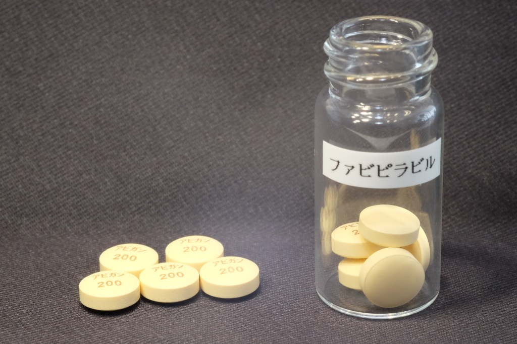 In this undated photo released by Fujifilm Holdings Corp., anti-influenza tablets fabipiravir are shown. Japan said Monday, Aug. 25, 2014 it is ready to provide a Japanese-developed anti-influenza drug as potential treatment to fight the rapidly expanding Ebola outbreak. The drug, developed by a Fujifilm subsidiary Toyama Chemical Co. to treat novel and re-emerging influenza viruses, was approved by the Japanese health ministry in March. Fujifilm is in talks with the U.S. Food and Drug Administration on clinical testing of the drug in treating Ebola, company spokesman Takao Aoki said. The label reads: fabipiravir.