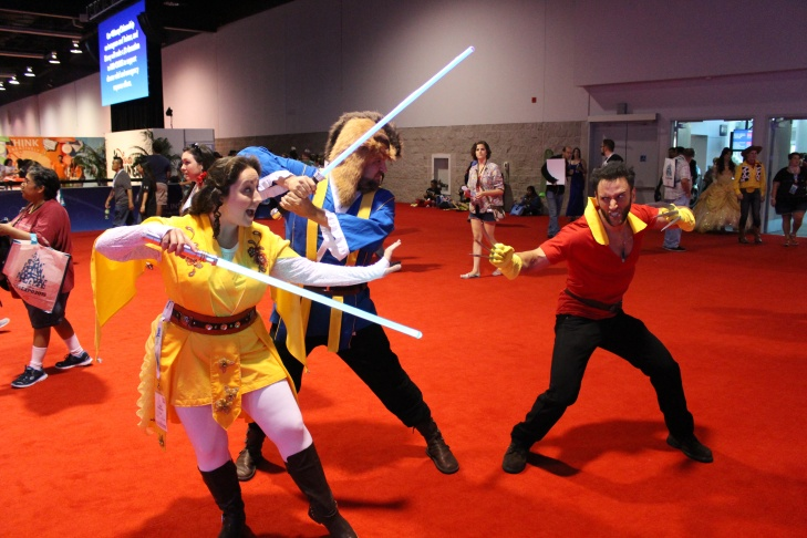 Fans dressed as Disney mash-ups face of at D23 Expo 2015 in Anaheim. It's Star Wars versions of Beauty and the Beast versus a combo Gaston/Wolverine.