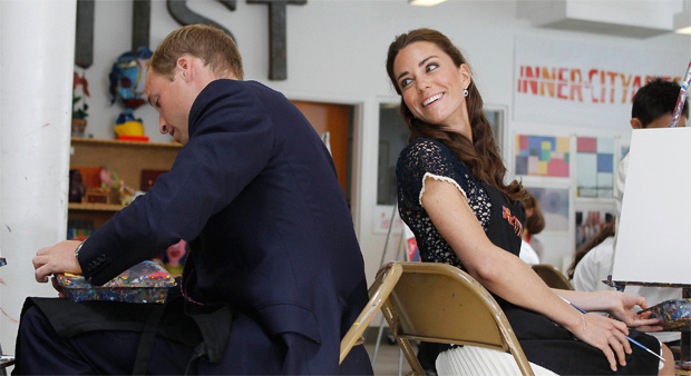 Prince William and his wife Catherine, Duchess of Cambridge, exchange conversation as they sit down to paint a picture during their tour of the Inner City Arts campus in Los Angeles, California, on July 10, 2011.