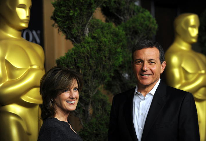 Senior Vice President, Franchise Management, Disney/ABC Television Group Adam Sanderson (L) and Co-chair of Disney Media Networks and president of Disney/ABC Television Group Anne Sweeney in the audience at the 39th AFI Life Achievement Award honoring Morgan Freeman held at Sony Pictures Studios on June 9, 2011 in Culver City.