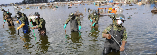 In Sendai, which is outside the evacuation zone around the crippled Fukushima nuclear power plant, members of the Japanese Self-Defence Force searched for bodies today (March 28, 2011).