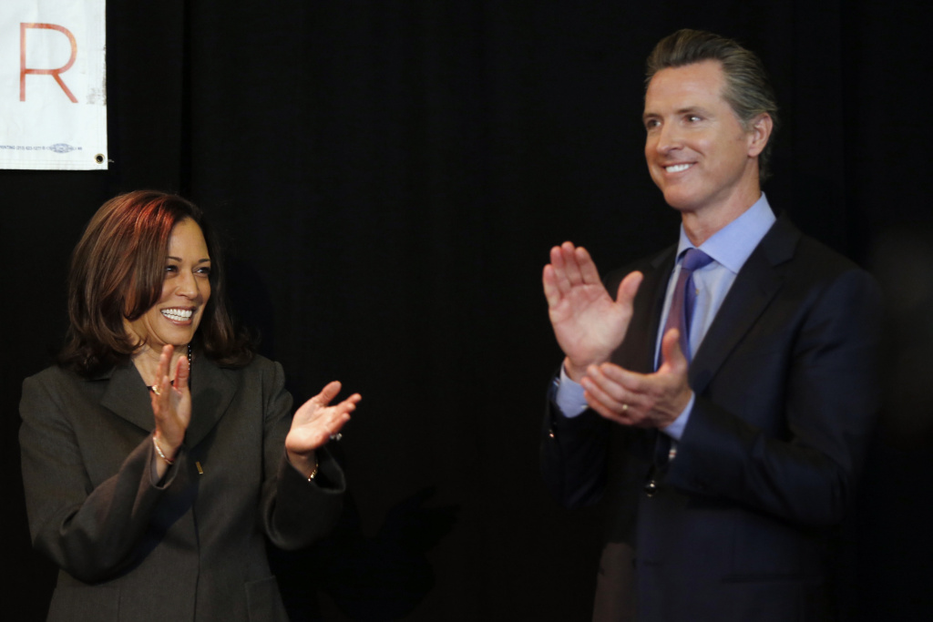 Vice President-elect Kamala Harris, left, and California Gov. Gavin Newsom in 2018. Newsom will appointment a successor to Harris in the Senate, a highly-coveted seat among California Democrats.