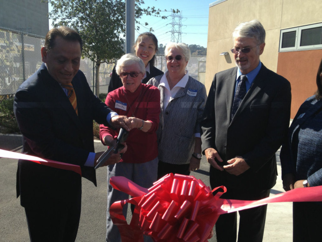 The late astronaut Sally Ride's mother Joyce Ride and her sister Bear Ride help with the ribbon-cutting on The Sally Ride Center for Environmental Science at L.A. Unified. Democratic Assemblyman Gil Cedillo of Los Angeles helps hold the scissors. School board member Bennett Kayser looks on.