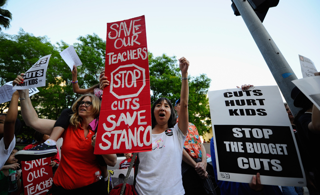 Teachers participate in an education budget cut rally and protest at Pershing Square on May 13, 2011 in downtown Los Angeles, California.