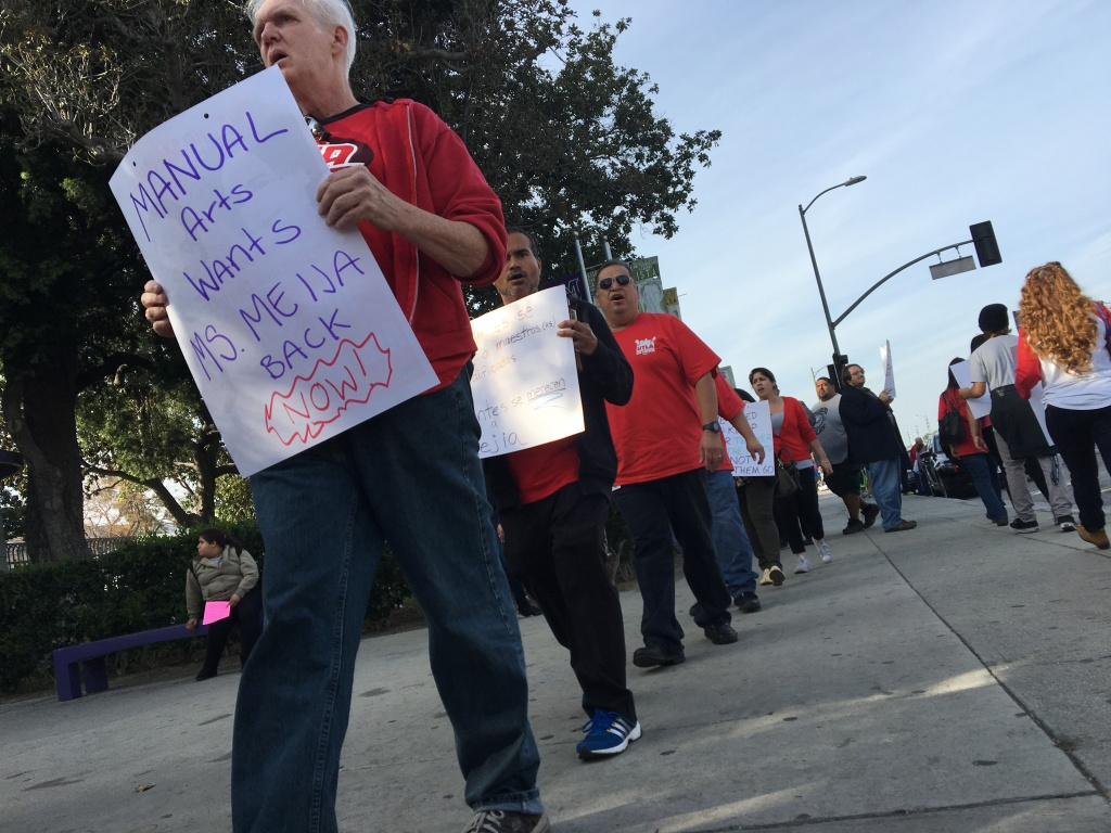 Members of the United Teachers Los Angeles union march outside Manual Arts High School in South L.A. calling for the reinstatement of teacher Roshni Mejia, who co-chaired the school's union chapter.