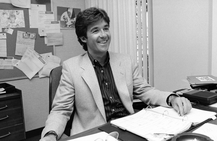 """File: Alan Thicke, then-host of """"Thicke of the Night,"""" smiles as he answers questions during an interview on Thursday, Sept. 10, 1983 in his office at Metro Media Square, Los Angeles."""