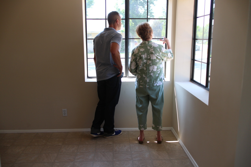 A Martinez and real estate agent Myra Elder survey a home in San Bernardino.