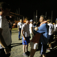 Regatta participant Robert Luiten of Mobile, Ala., right, rejoices on learning that his son, Leonard Luiten, was found after their boat capsized in a storm on Saturday, in Dauphin Island, Ala. The Coast Guard is still searching for four missing sailors.