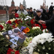 People lay flowers on Saturday at the place where Boris Nemtsov, a charismatic Russian opposition leader and sharp critic of President Vladimir Putin, was gunned down, at Red Square in Moscow, Russia.