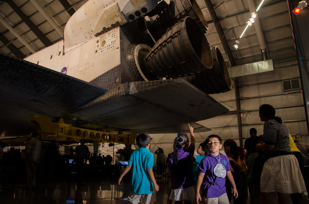 A group of children look up at Endeavour during the grand opening of the exhibition at the California Science Center in Los Angeles, Calif., October 30, 2012.