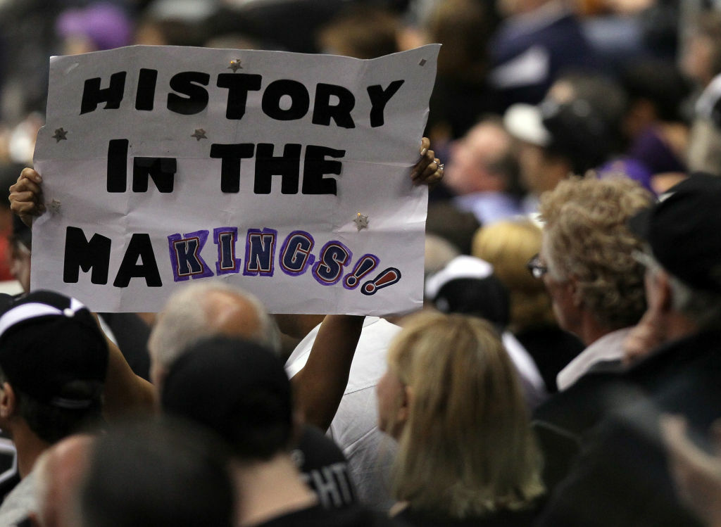 A Los Angeles Kings fan holds up a sign