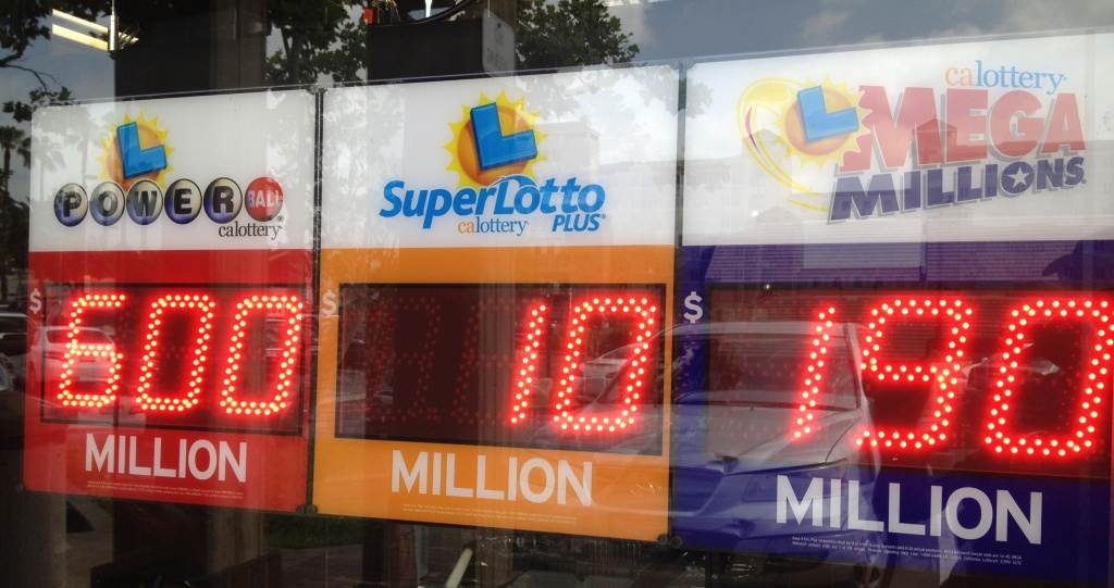 California became the 43rd state to offer the Powerball lottery in April 2013. The Powerball jackpot has climbed to a record $600 million for the Saturday, May 18 drawing. (Photo: Sign in store window displays Powerball lottery jackpot of $600 million. Ed Joyce/KPCC)
