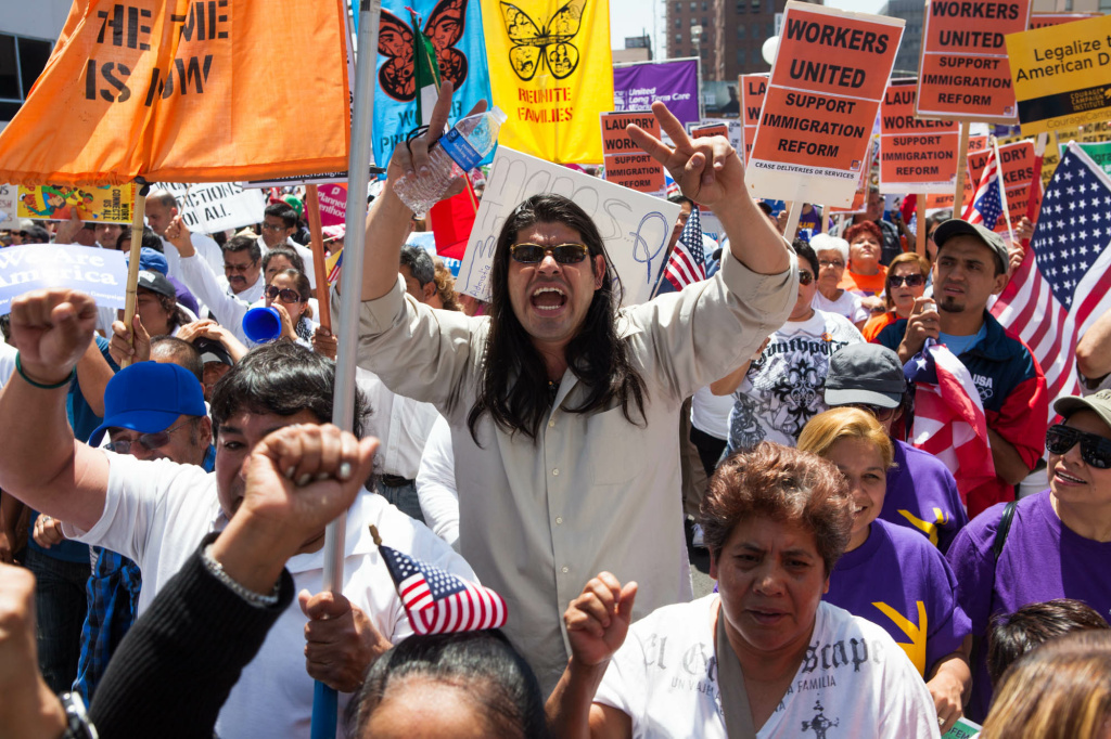 May Day protesters shout slogans calling for immigration reform as they make their way through Downtown Los Angeles.