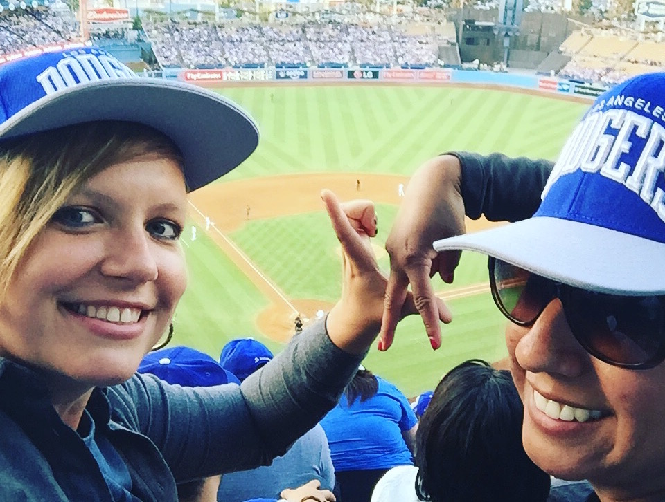 KPCC listener Julie Van Winkle (L) and her friend Adriana Santana at a Dodgers game.