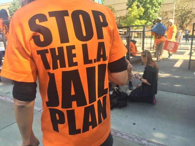 More than 150 activists protested L.A. County's plan to build a new mental health jail. They argue the money should be spent instead on community mental health programs.