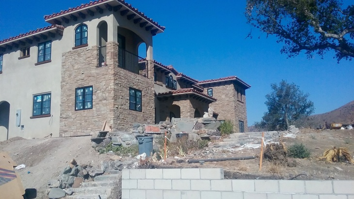 Gena Palo's family lost its home in the Glendora foothills during the 2014 Colby Fire. They hope to move in to their new house built in the same location by Christmas - nearly three years since the fire.