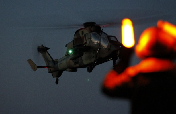 French helicopter lands off the Libyan coast after an airstrike targeting Gadhafi forces. Will the U.S. maintain its military presence in Libya?