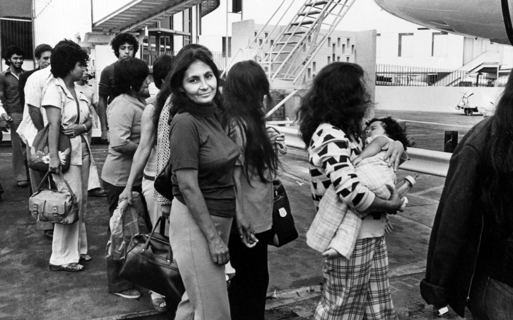 Mexican immigrants in the country illegally, among them a woman carrying a baby, are boarding a plane in Los Angeles, Calif., as they are being deported back to their native Mexico, July 27, 1976.