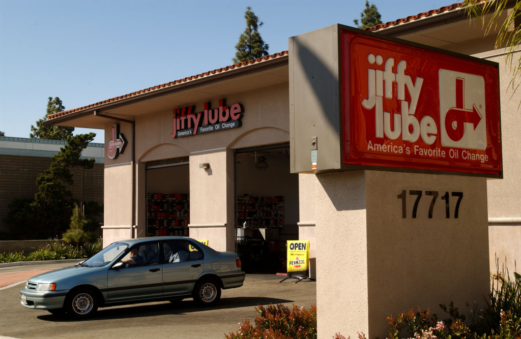 A car leaves a Jiffy Lube store after an oil change March 26, 2002 in Los Angeles.