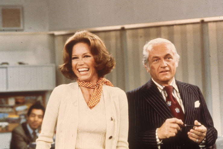 Actors Mary Tyler Moore and Ted Knight laugh in a still from