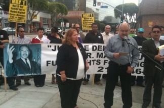 Immigrants' and workers' rights advocates announce plans for a May 1 march during a small rally in downtown Los Angeles on April 13, 2011.