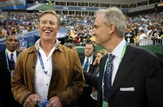 Hall of famer John Elway (left) and ESPN commentator Trey Wingo on the field prior to Super Bowl XLIII between the Arizona Cardinals and the Pittsburgh Steelers on Feb. 1, 2009 in Tampa, Florida.