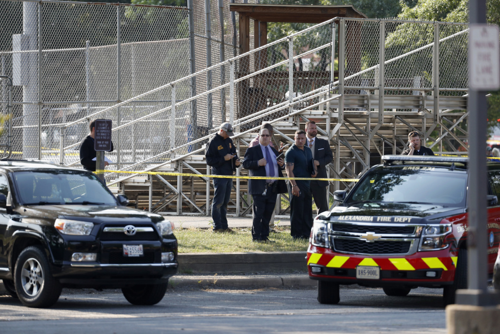 Law enforcement officers investigate the scene of a shooting near a baseball field in Alexandria, Va., Wednesday, June 14, 2017, where House Majority Whip Steve Scalise of La. was shot at a Congressional baseball practice. (AP Photo/Alex Brandon)