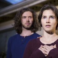 Amanda Knox speaks to the media during a brief press conference in front of her parents' home March 27, 2015 in Seattle, Washington. Standing behind Knox is her fiance Colin Sutherland.
