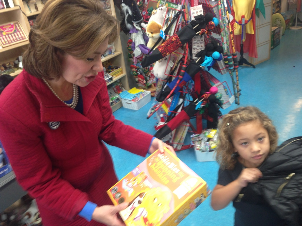Maria Contreras-Sweet, the head of the federal Small Business Administration, buys a toy for her granddaughter Elisa Sweet in Los Angeles.