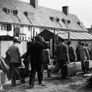April 1940: Internees with their luggage arriving at internment camp. (Photo by Fox Photos/Getty Images)