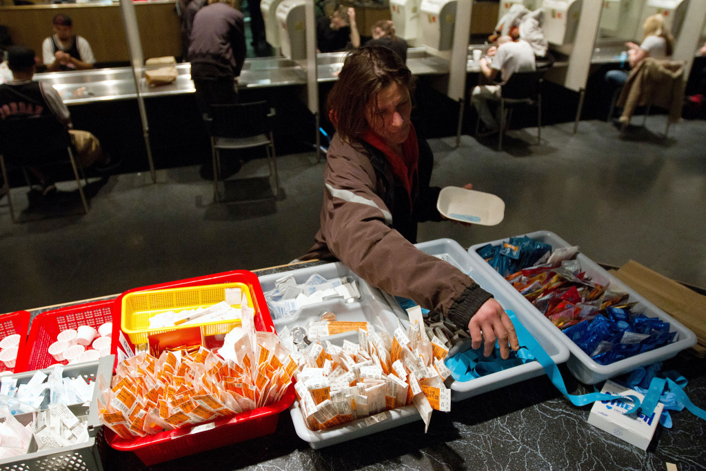 A client of the Insite supervised injection Center in Vancouver, Canada, collects her kit on May 3, 2011.