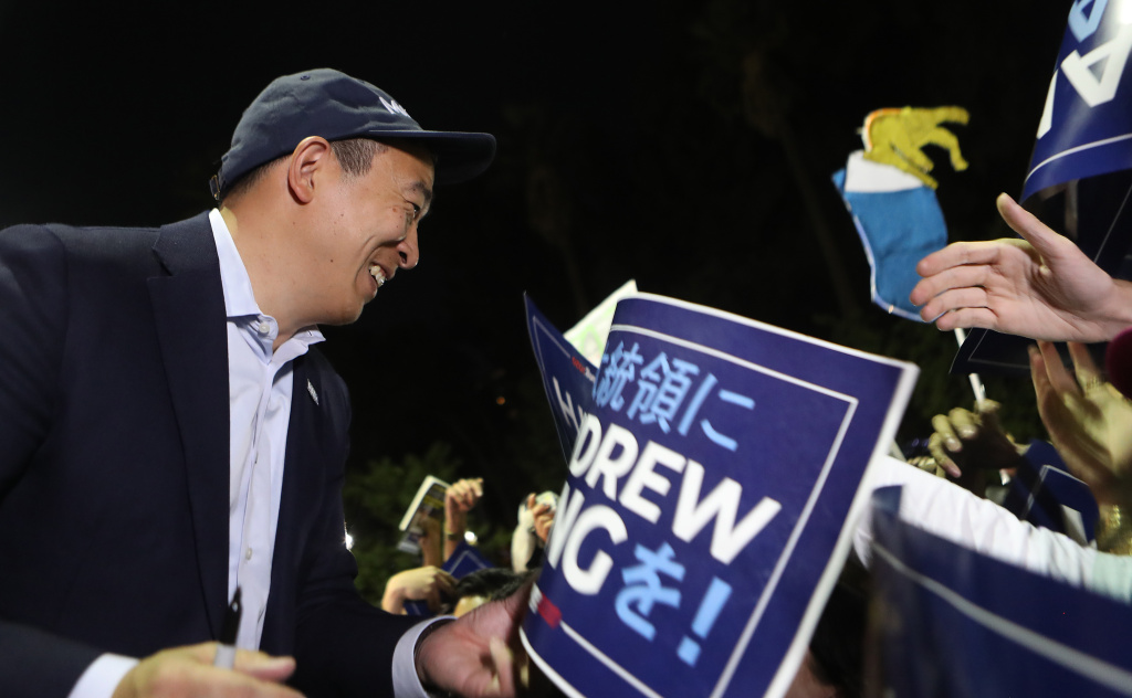 Democratic presidential candidate and entrepreneur Andrew Yang (L) greets supporters at a campaign rally on September 30, 2019 in Los Angeles, California.