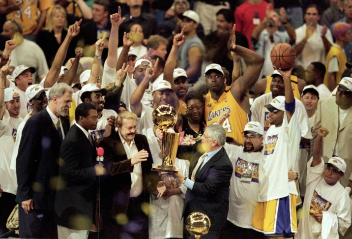 Commissioner David Stern presents owner of the Los Angeles Lakers Jerry Buss the NBA Championship trophy in action during the NBA Finals Game 6 against the Indiana Pacers at the STAPLES Center in Los Angeles, CA.