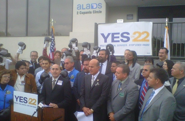 Los Angeles County Sheriff Lee Baca, center, joins local officials, transportation advocates and others at a news conference Oct. 18, 2010 in Monterey Park to rally support for Proposition 22.